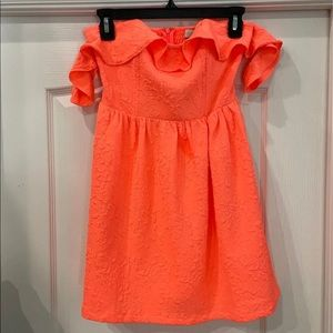 Hope's neon coral dress